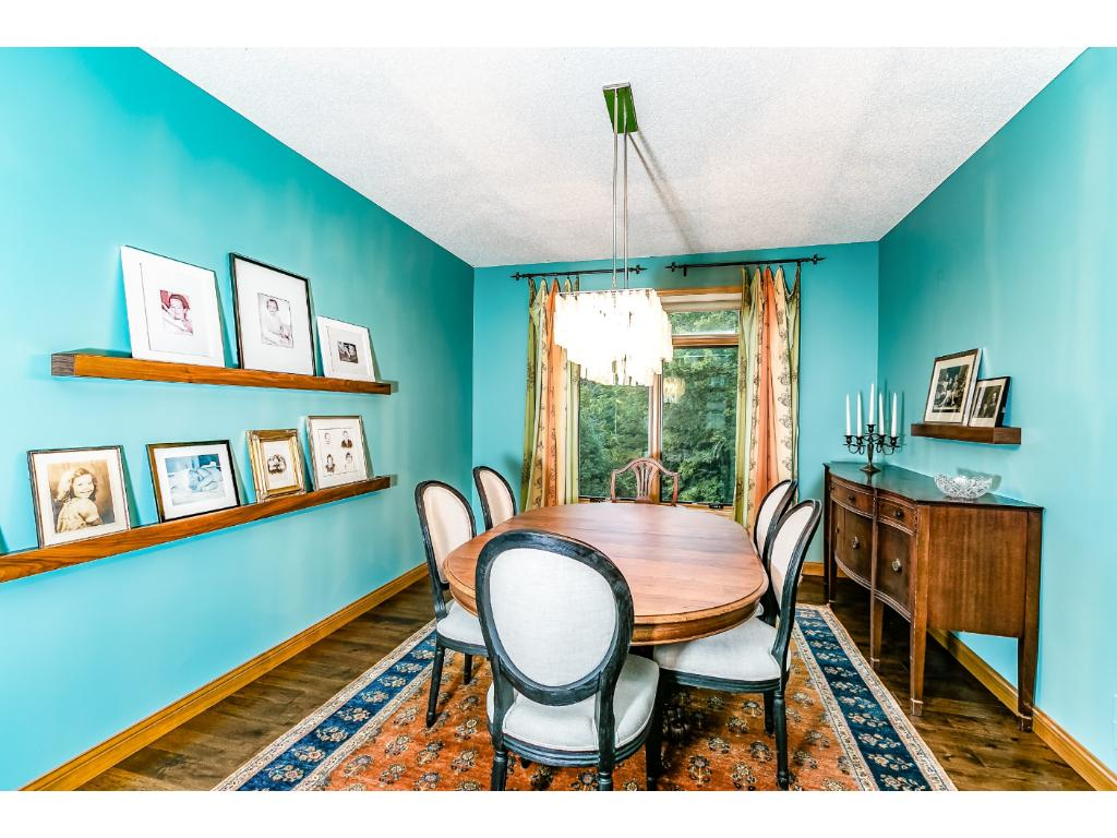 Formal Dining Room is spacious and has a stunning new light fixture.