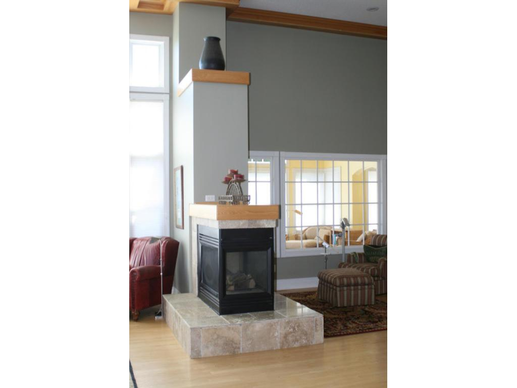 Three sided gas fireplace in LR