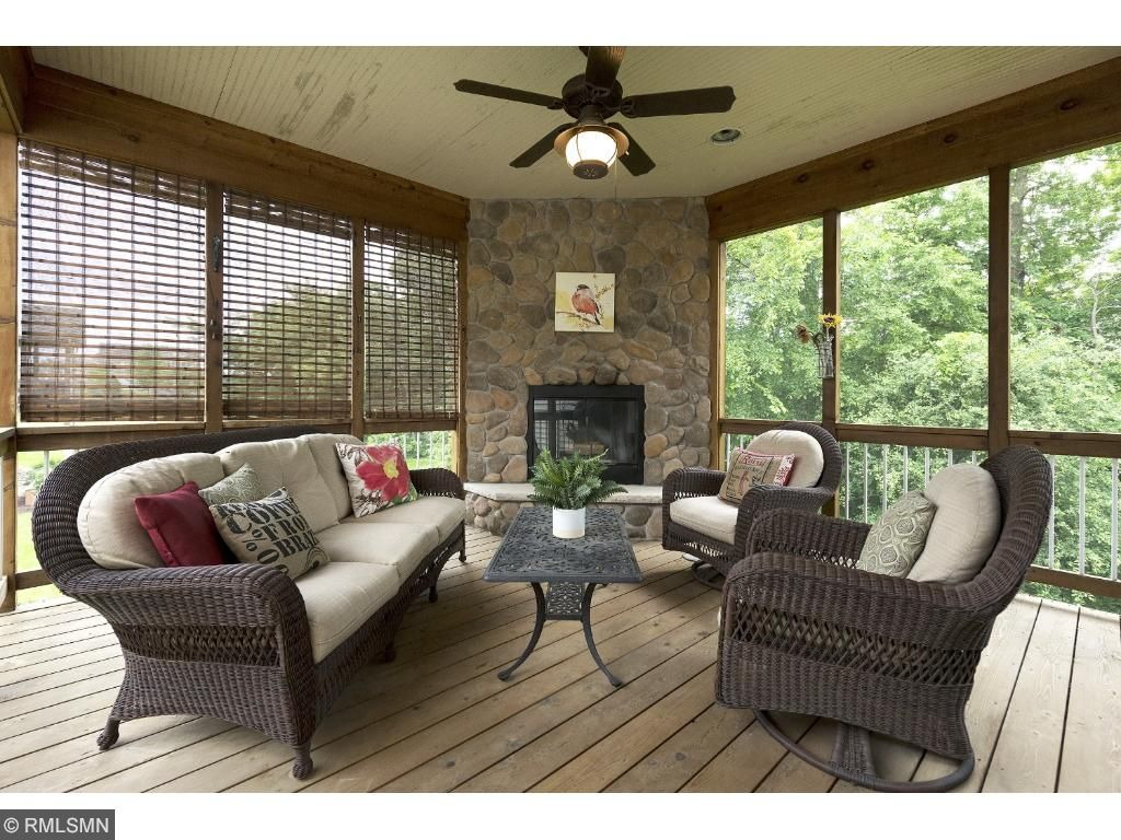The screened porch is the perfect place to relax or entertain with the wood burning fireplace and screen door to deck which overlooks the professionally landscaped backyard.