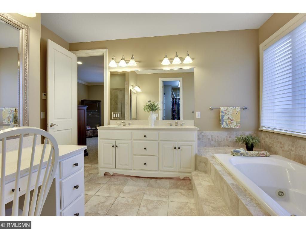 The Master Bath has crown molding, double vanity, dressing table, ceramic shower and bayed window.  The walk-in closet has California organizers and shelving.