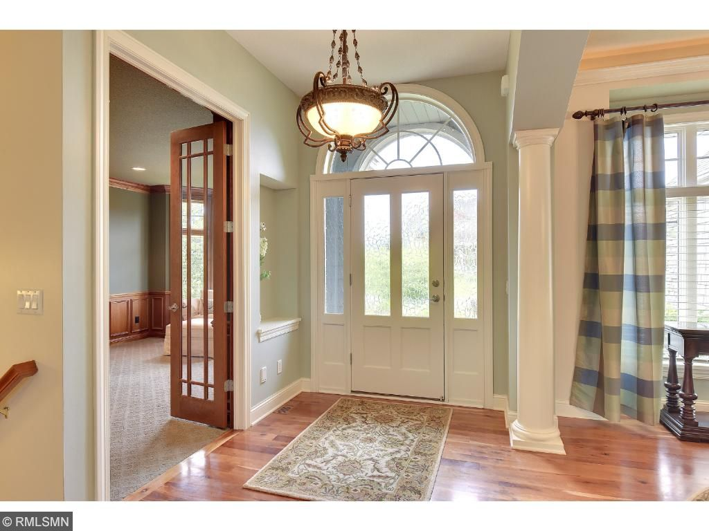 This is an open, inviting home with all details, Beautiful archways, pillars and high-end light fixtures which create a fabulous ambiance to the home.