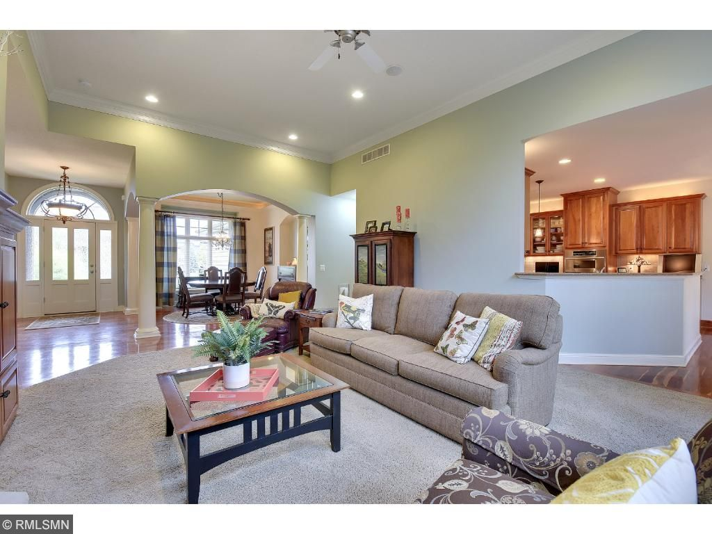 Great room has 18' cieilings, cherry crown molding and cherry built-in cabinets along with a gas fireplace.