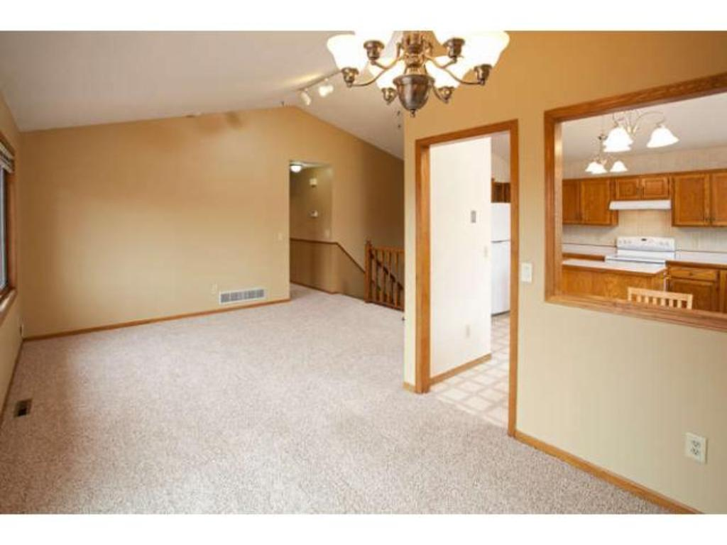 The Dining Room has a sliding door that leads to a large 2 tiered deck with custom built-in seating