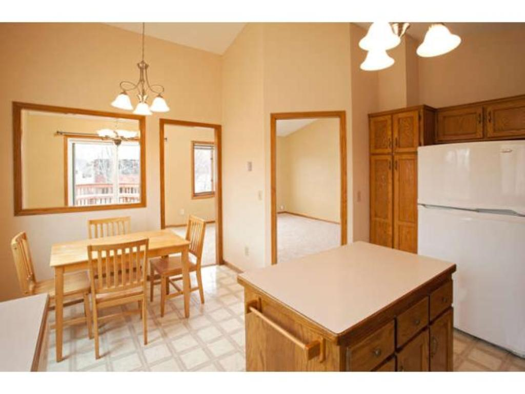 Spacious Eat-in Kitchen features Center Island and updated Lighting