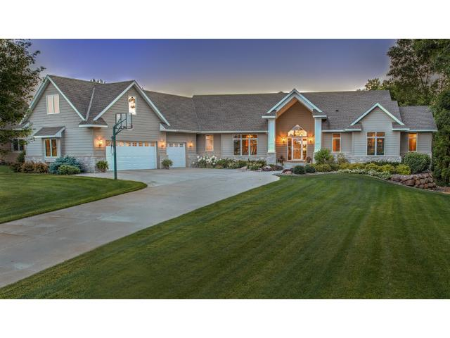 Captivating executive walk out rambler with breathtaking setting and amazing sunsets!