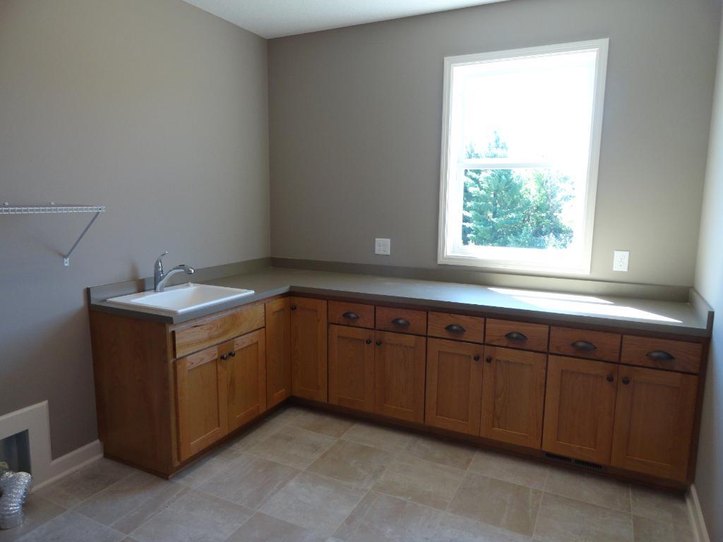 Main level laundry room photo from a similar home