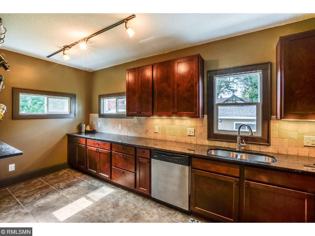 Kitchen with maple cabinetry and granite countertops