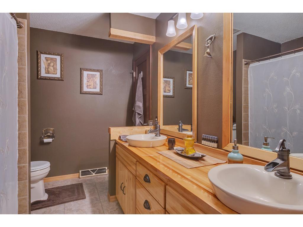 Tasteful main floor bath features double vessel sinks