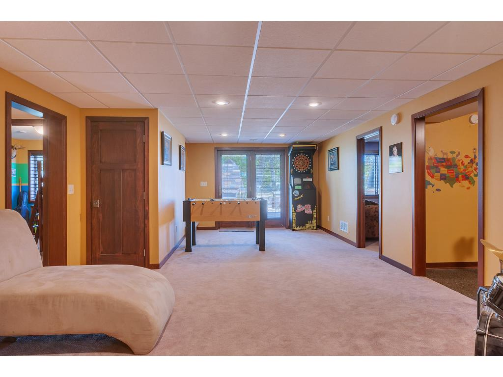 The lower level is comprised of more than one great entertaining space!