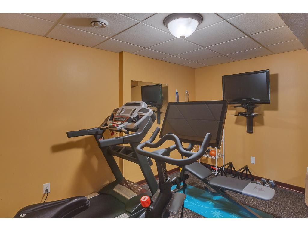 The exercise room is wired for TV and features rubber floors!