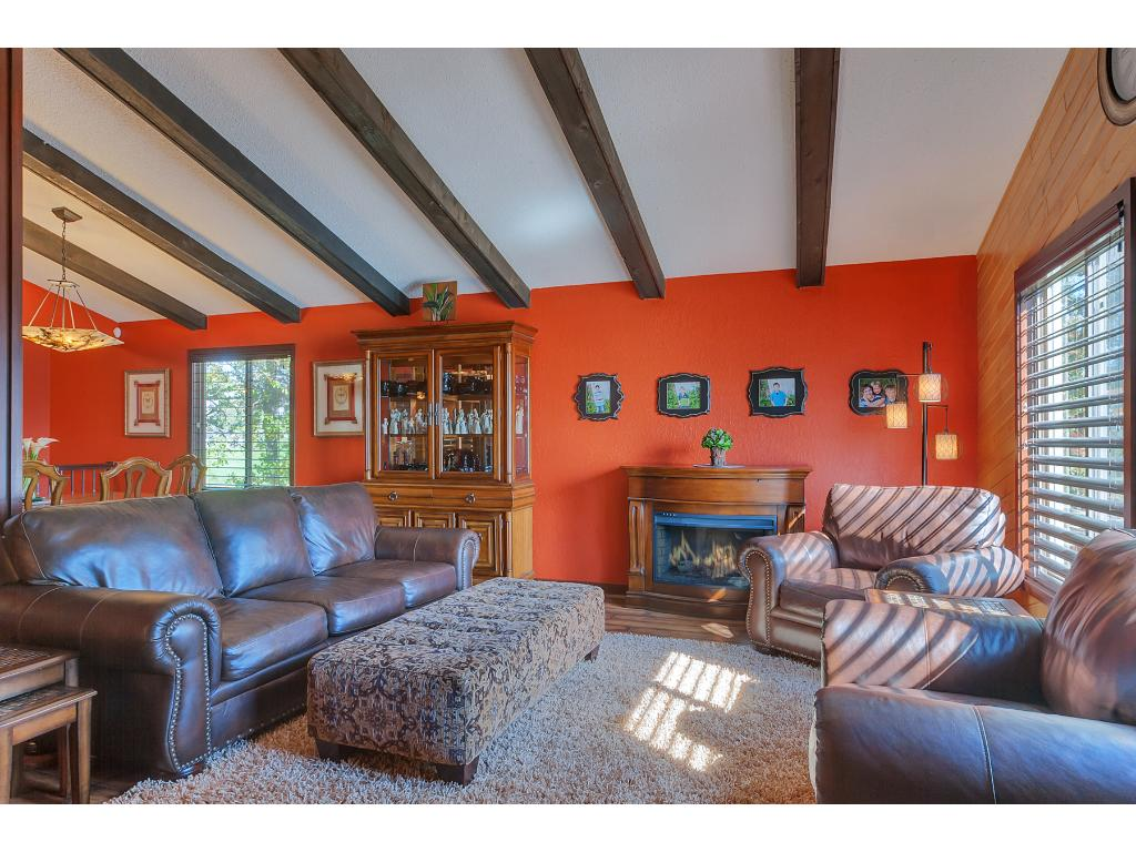 Notice how the vaulted ceilings with exposed beams carry throughout the entire main floor.