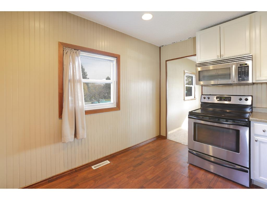 Laminate hardwood flooring gives the kitchen an updated look and is durable and easy to clean.