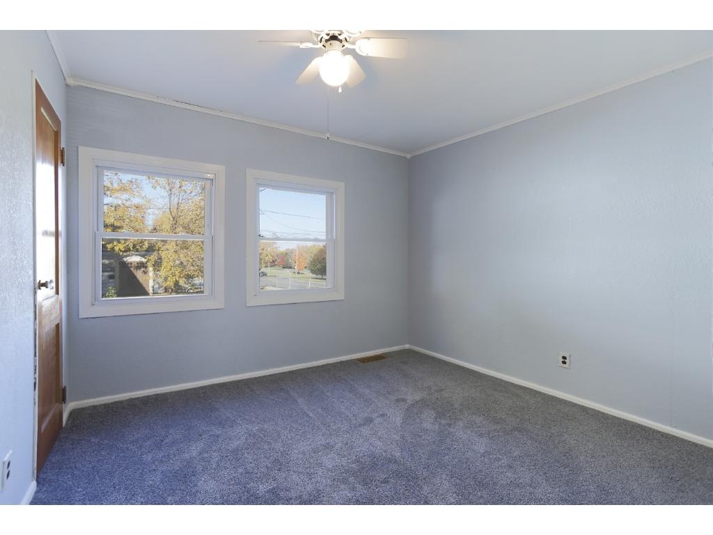 Another of the main floor bedrooms with fresh carpet and paint.