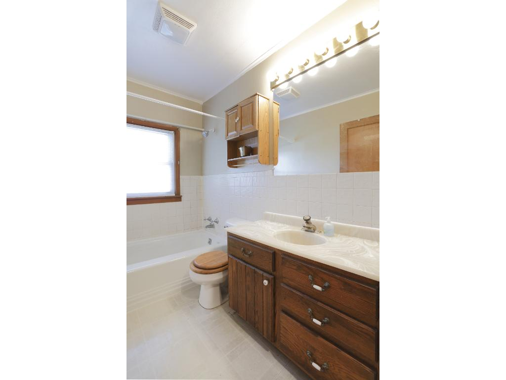 The full bath offers great storage space and is light and bright.