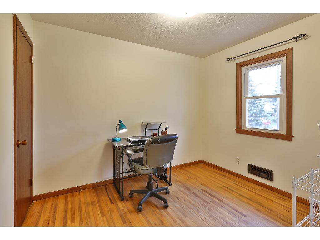 The third bedroom is currently used as an office and overlooks the front yard.
