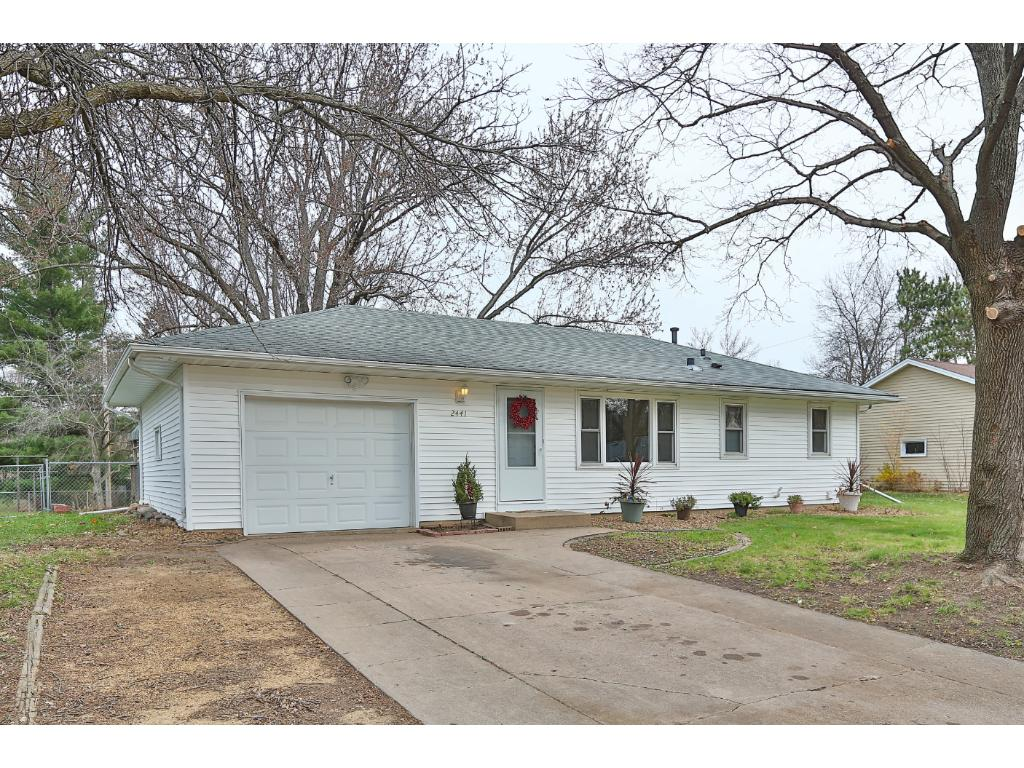 The maintenance free exterior, mature trees, and concrete driveway are a plus!