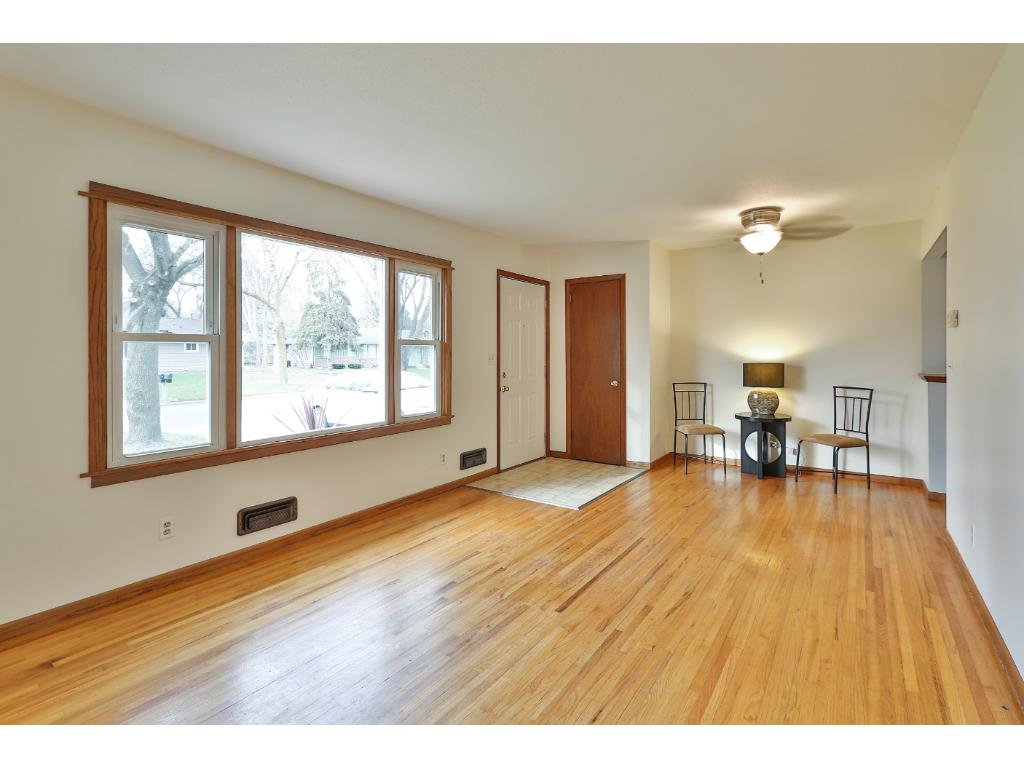 Gleaming hardwood floors in the living room greet you at the entry.  There is even room for a small dining area!