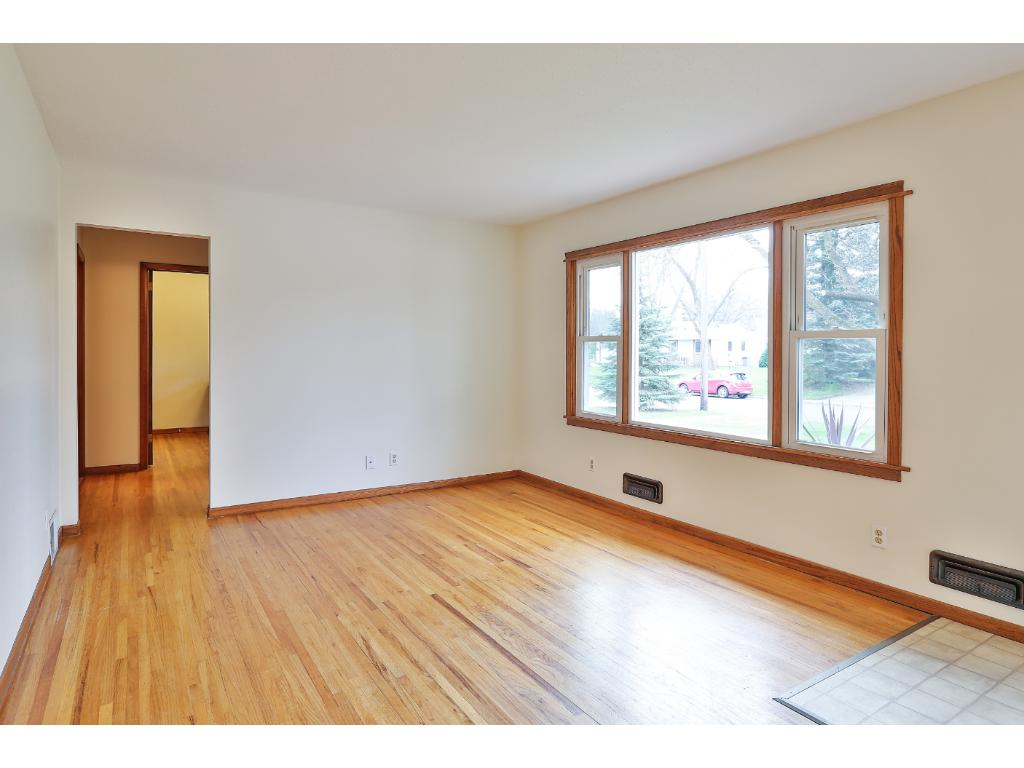 The newer large picture window brings in plenty of natural light.