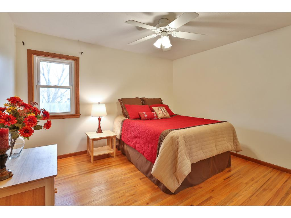 The master bedroom also has beautiful hardwood floors, a ceiling fan, and large double closet.