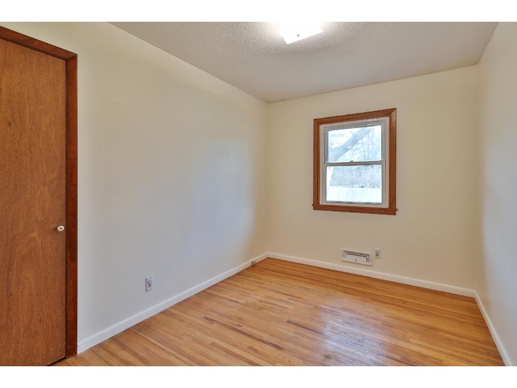 The second bedroom also has hardwood floors and overlooks the large back yard.