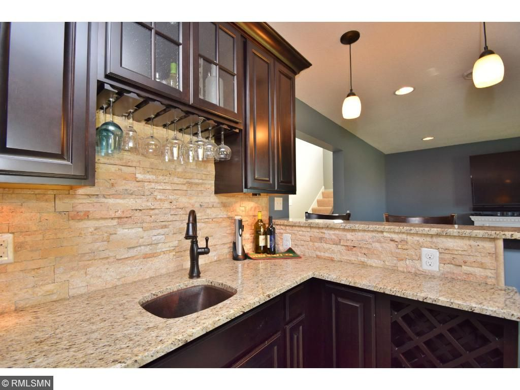 Perfect spot to entertain with wine fridge, wine rack, wet bar and so much more.