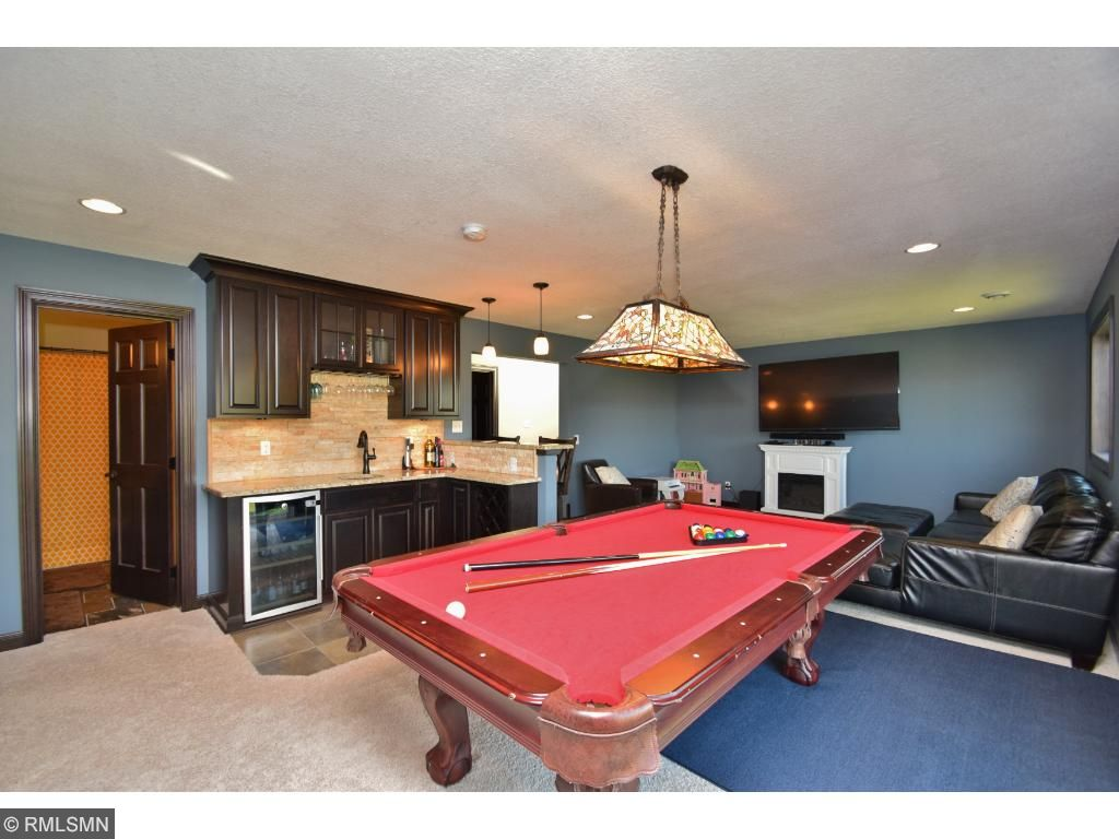 Room for pool table, game table, etc. Lower level walks out to huge backyard.