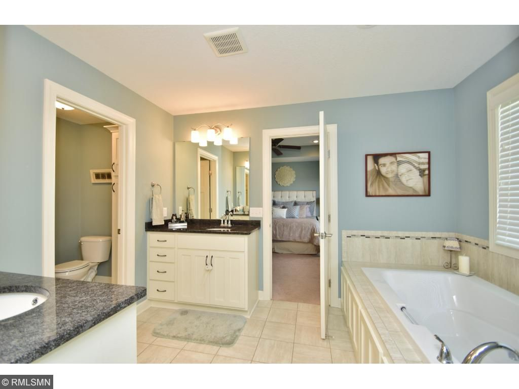 Relax in this beautiful bathroom with huge soaking tub and separate shower.