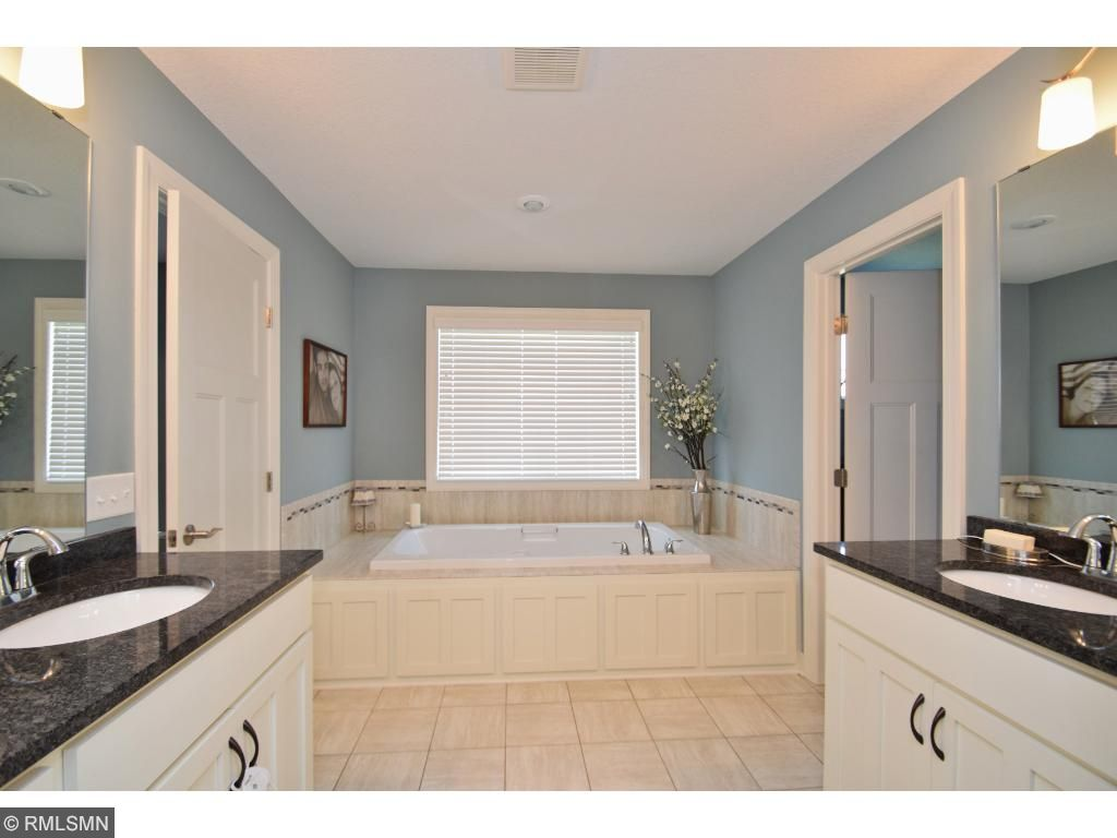 Dual sinks with separate vanities makes this bathroom so convenient.
