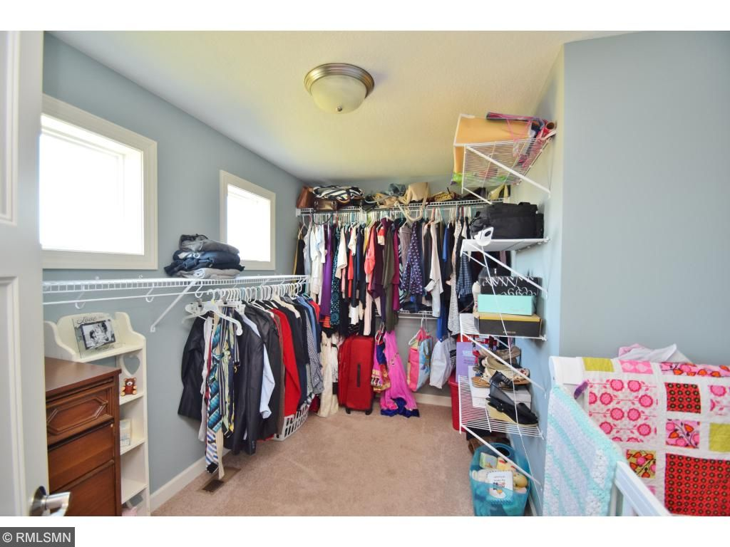 This spacious walk-in closet is perfect for all your treasures.