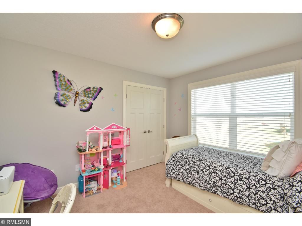 Another one of four spacious bedrooms upstairs.