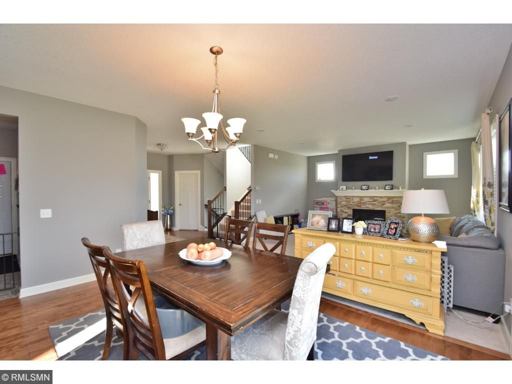 Large dining area overlooks great room and kitchen.