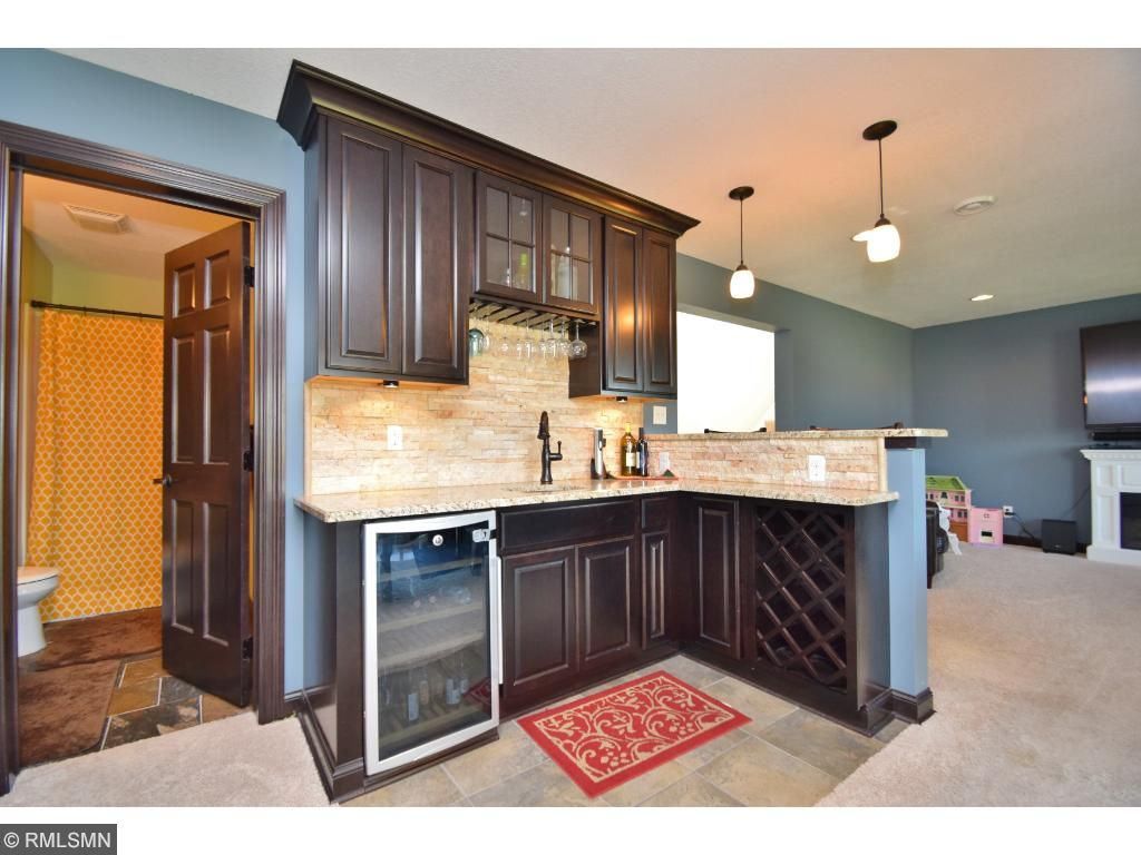 Check out this awesome wet-bar in the lower level. Beautiful granite, backsplash, and cabinetry for all your entertaining.