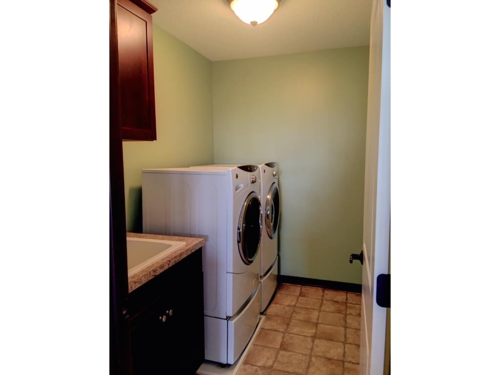 2nd floor laundry with large wash basin and good storage close to bedrooms make laundry easy!