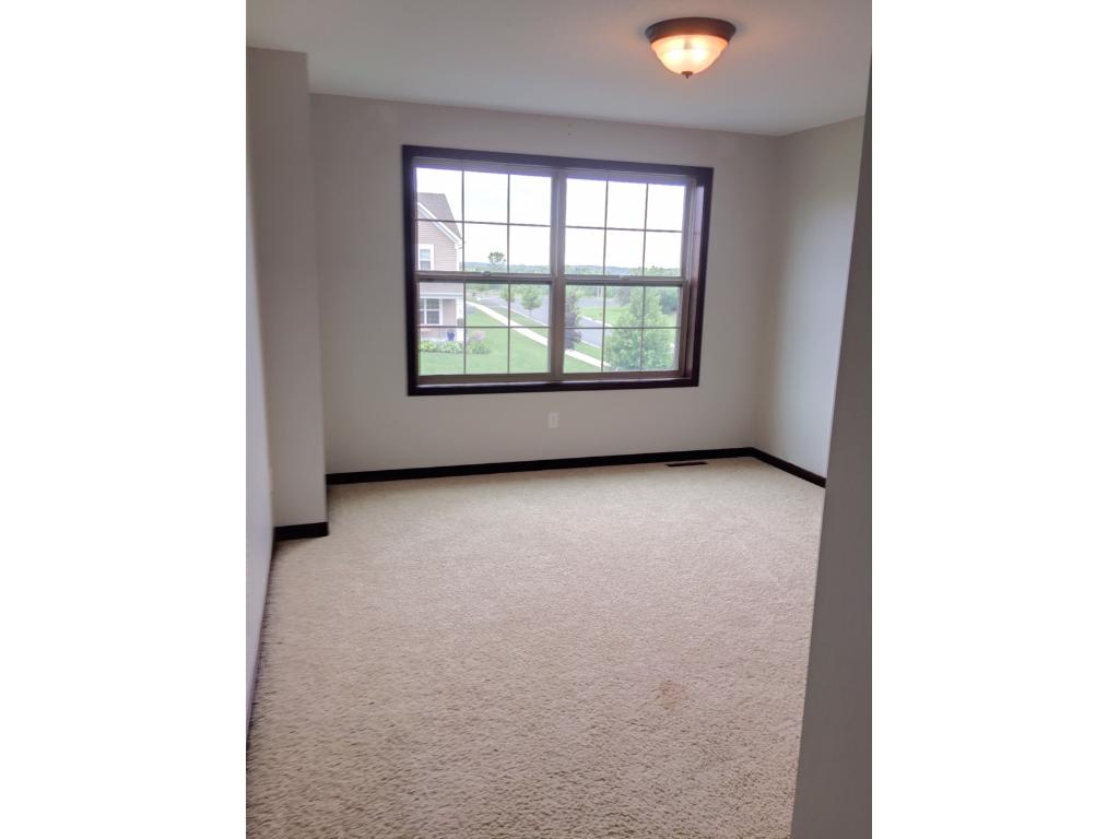 Upstairs bedroom overlooking front of the home.