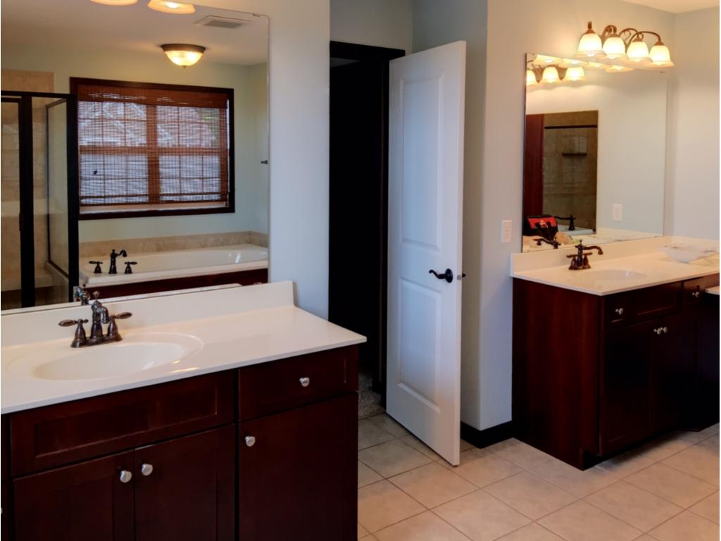 Large master bath with dual vanities and makeup counter.