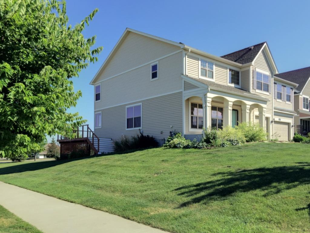 Great corner lot with inviting front porch and oversized deck, perfect for entertaining.