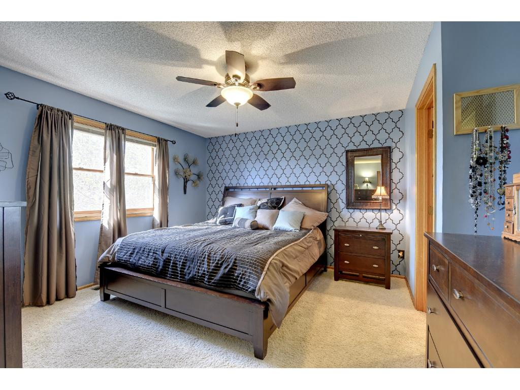 Luxurious master suite is roomy -- includes a walk-in closet and walk thru master bath.
