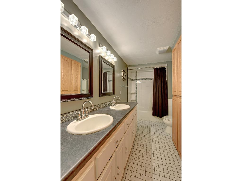 Both bathrooms feature new counters, mirrors faucets and lighting!