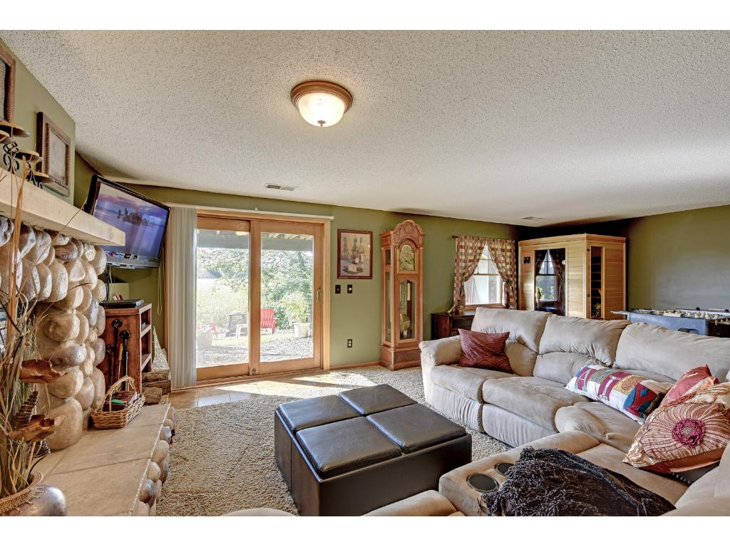 The comfortable family room with a wood burning fireplace is the perfect space to relax and unwind.