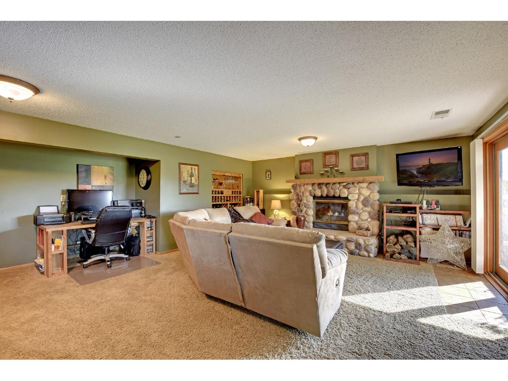 A built-in wine rack, an office nook, and work out area round out the walkout lower level.
