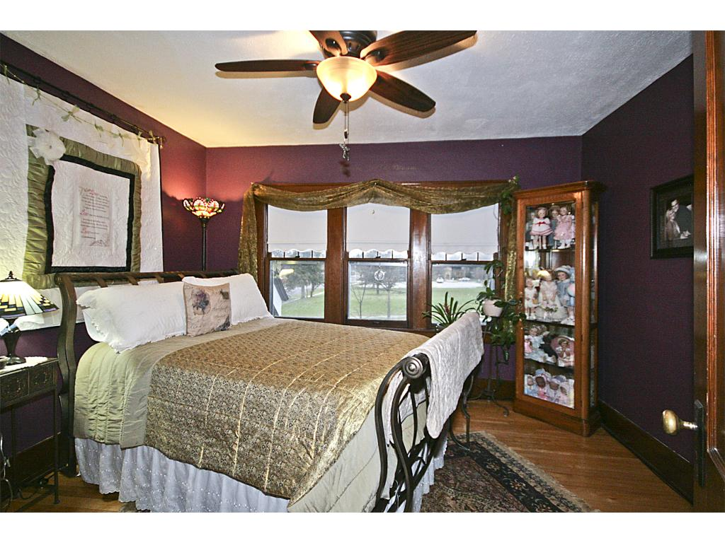 Master bedroom with Maple hardwood floors and double closets.