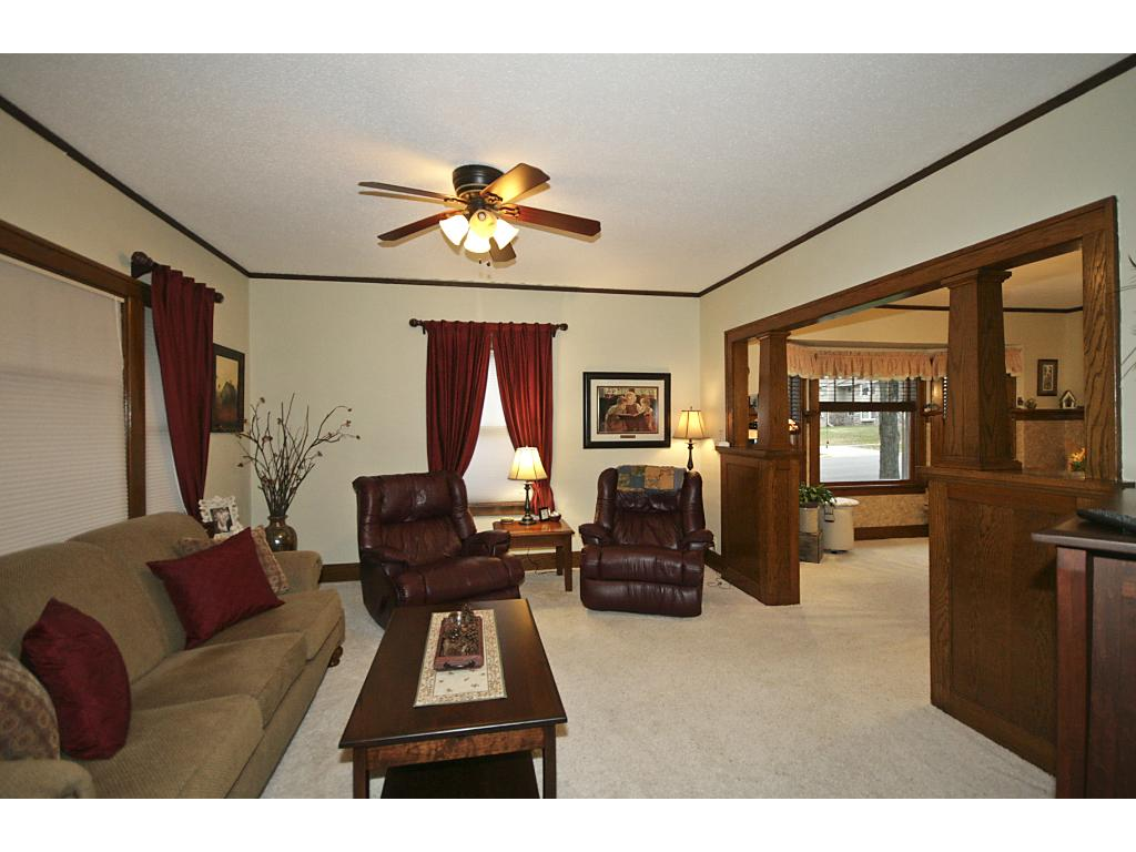 Original woodwork throughout living room.