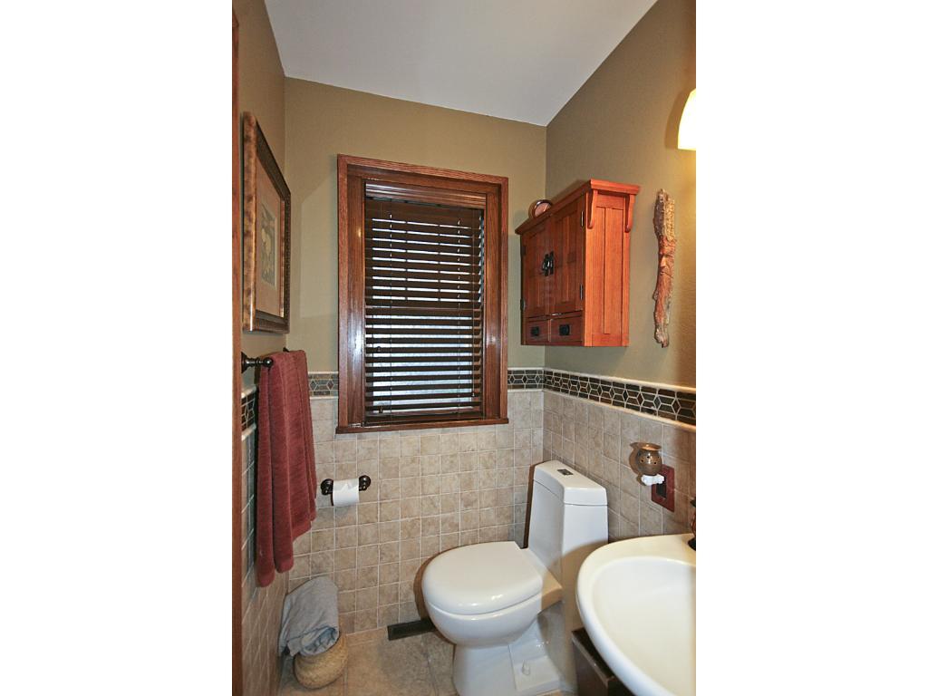 3/4 bathroom on main floor. Tile floor and shower w/glass door, in-floor heat.