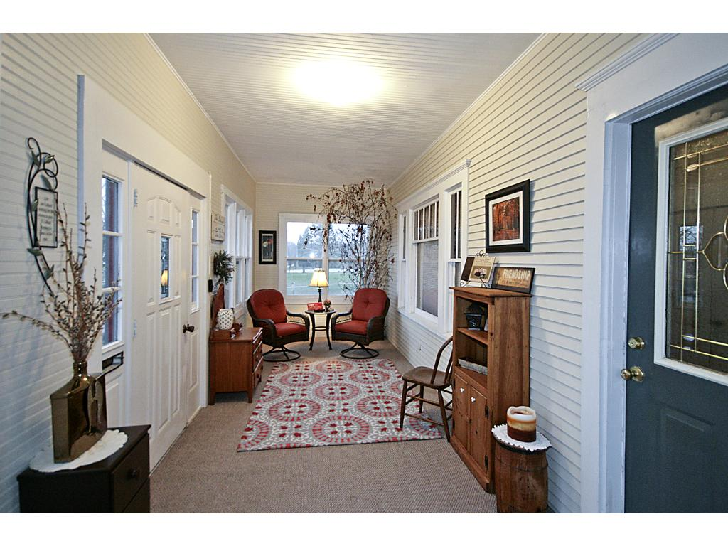 Enjoy a book with a cup of coffee in this cozy front porch, 25x8'.