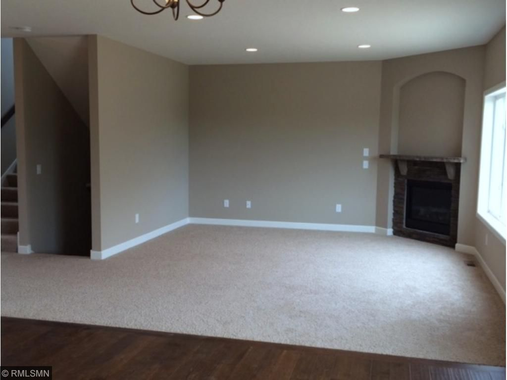 Great room with corner stone fireplace. White enamel trim throughout. 9 foot ceilings on main.