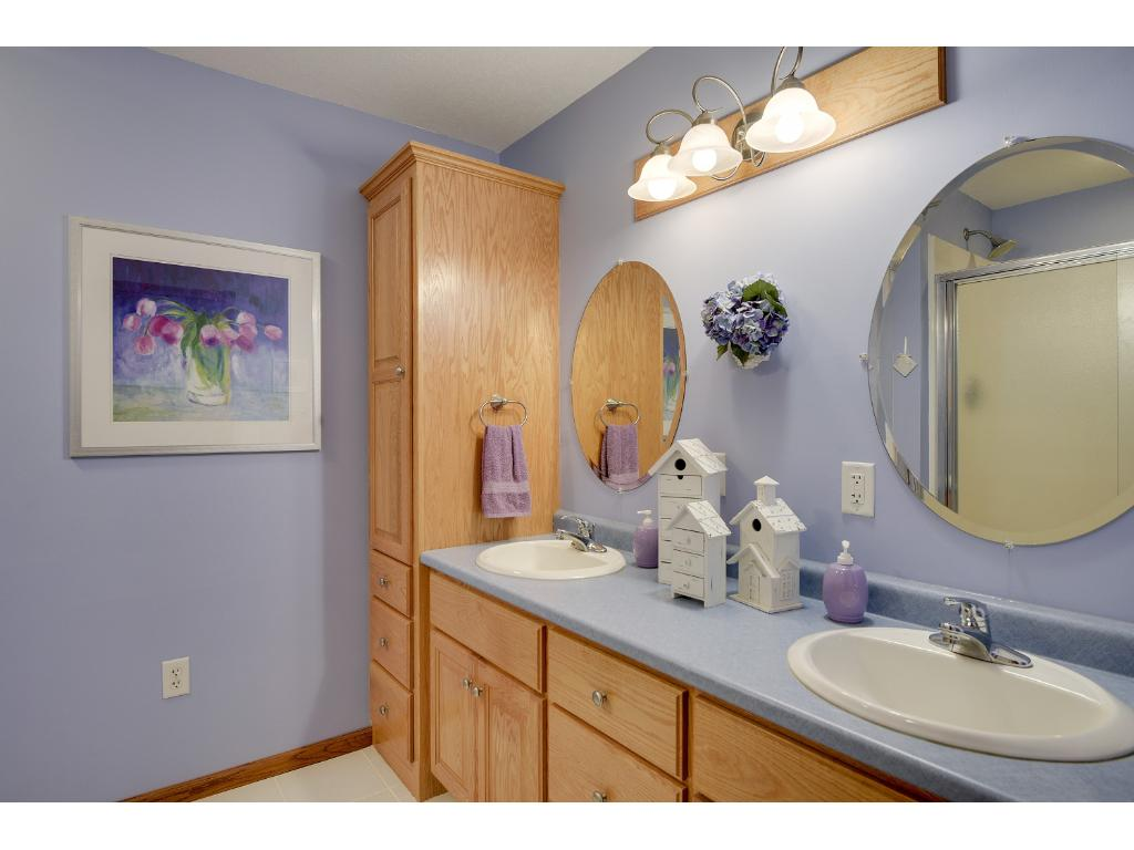 The Master Bedroom Features a Dual Sink Vanity, Full Linen Cabinet and a Walk In Shower.