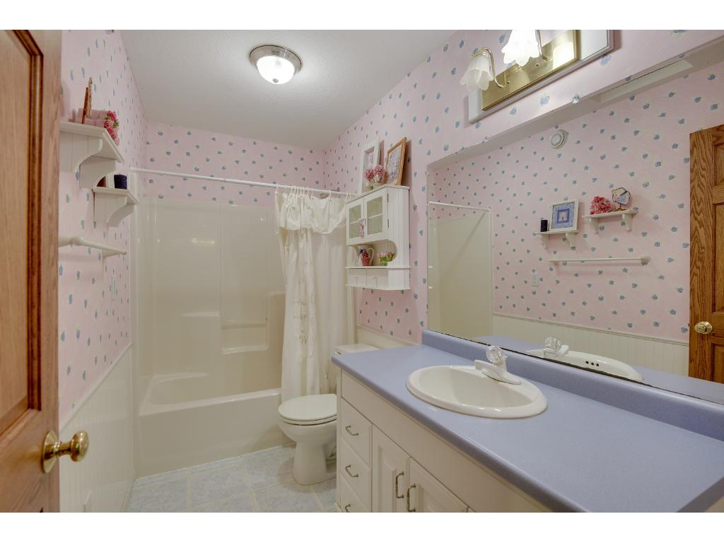 Lovely Full Bath off Hallway on Upper Level.