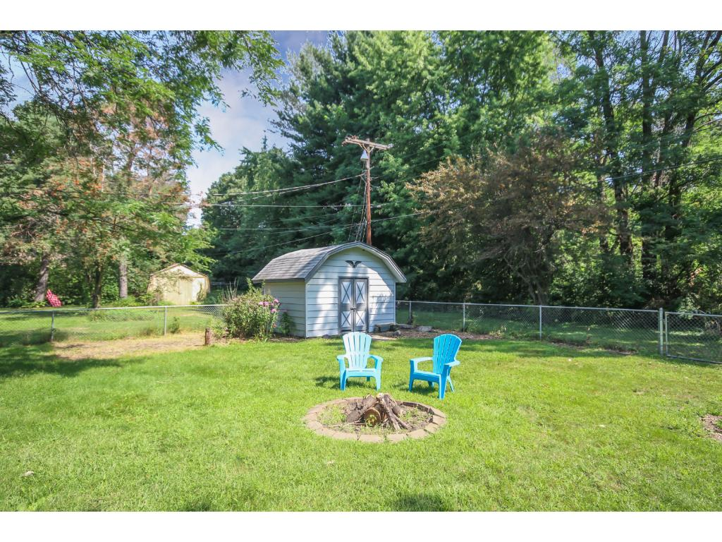 Amazing fully fenced yard with shed and firepit.  Walk right out to the biking/hiking trail behind!
