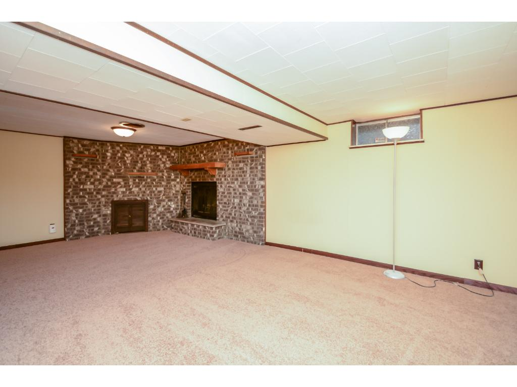 Large lower level family room with wood burning fireplace, new carpet, paint and plenty of space for entertaining, home theater, pool table, etc!