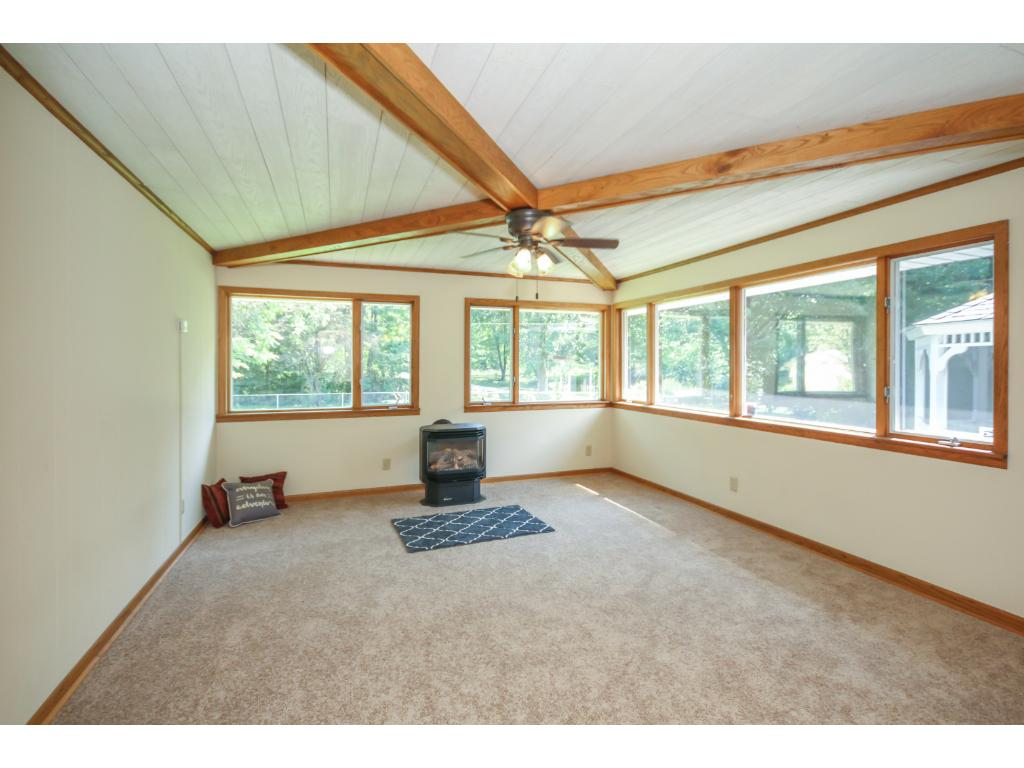 Amazing 4 season sun room addition with gas fireplace overlooking beautiful yard and park land!